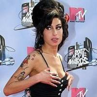Amy Winehouse showed off her healthy skin in London.