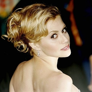 Murphy would often play up her movie star status with elegant updos like the one seen here