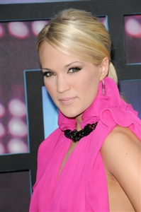 Carrie Underwood switched hairstyles at the CMT Awards.
