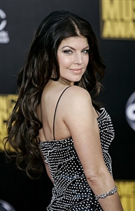 Fergie recently added highlights to her dark hair