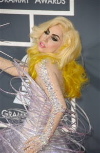 Lady Gaga seems to enjoy bejeweled getups and luminescent materials.