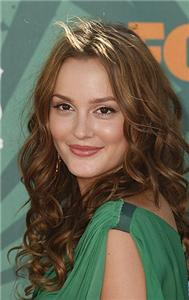 Leighton Meester Displays A Fun Hairstyle At Night Club Opening