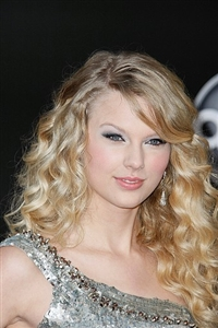 Swift recently traded her soft curls for a sleek new hairstyle