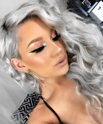 Ice Queen Waves Of Icy Silver Grey Hair Make A Phenomenal Contrast Against Bronzed Skin And Rose Gold Makeup