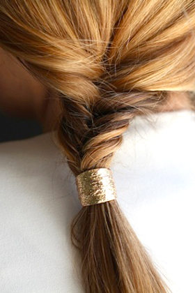 Use a wide barrette on a ponytail