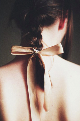 Tie a ribbon at the end of a braid