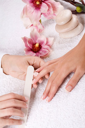 Get cuticle work and hard skin removed at a nail salon