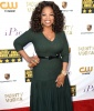 Oprah Winfrey highlights her figure