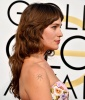 Lola Kirke's Face-Framing Short Bangs