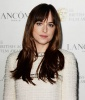 Dakota Johnson's Smooth and Straight 'Do