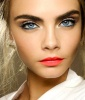 Matte coral lips with aqua eyes