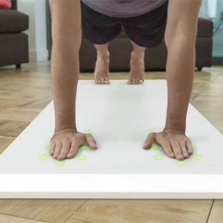 A Yoga Mat That Offers Tips? Yes, Please