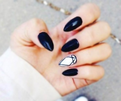 Black and white almond-shaped acrylic nails