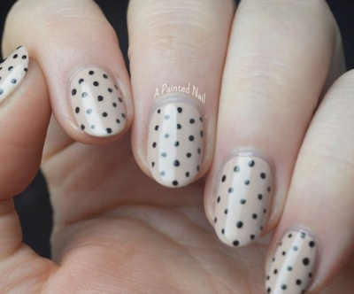 Try some polka dot nail art to elevate your nude manicure