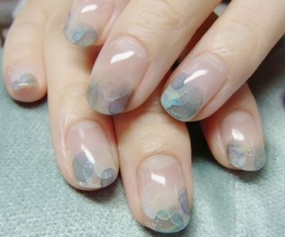 Nude nails look colorful and chic with watercolor nail art tips