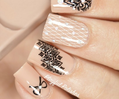 Try adding a pearl or other embellishment to give nude nails a lady-like charm