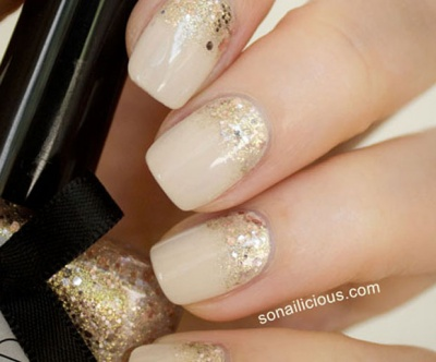 Add some glitter to your nude nails to make them pop