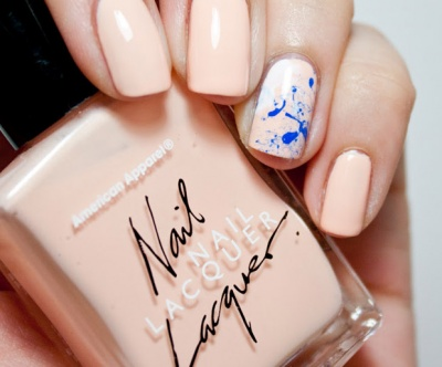Try colorful splatter nail art on top of nude nails for an update on the classic look