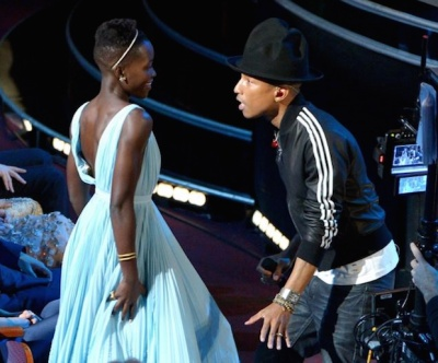 Williams dances with a soon-to-be-very-happy Lupita N'yong'o