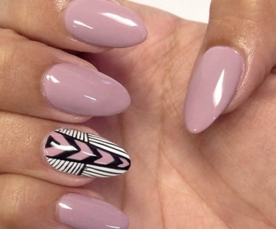 Almond-shaped acrylic nails with tribal accent nail